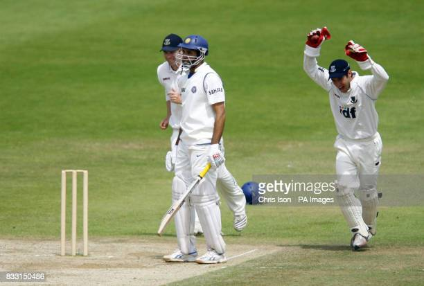 India batsman VVS Laxman is caught by Sussex Wicketkeeper Andy Hodd after the ball rebounded off Sussex fielder Michael Thornley from a ball by...