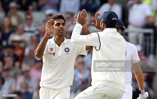 India bowler Bhuvneshwar Kumar celebrates taking the wicket of England batsman Sam Robson during play on the first day of the fourth cricket Test...