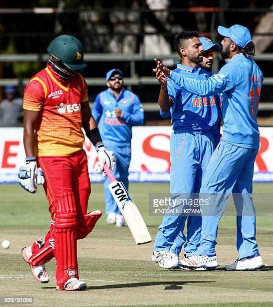 India bowler Dhawal Kulkarnicelebrates the wicket of Zimbabwe's Chamunorwa Chibhabha with teammate KL Rahul during the second One Day International...