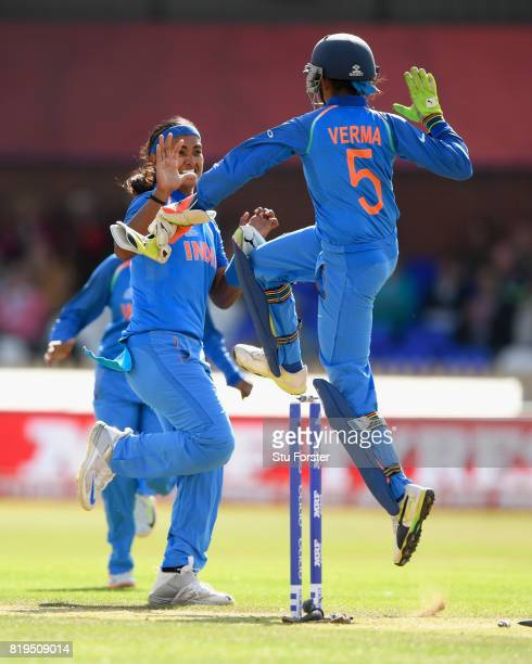 India bowler Shika Pandey celebrates with wicketkeeper Sushma Verma after Pandy had bowled Mooney during the ICC Women's World Cup 2017 SemiFinal...