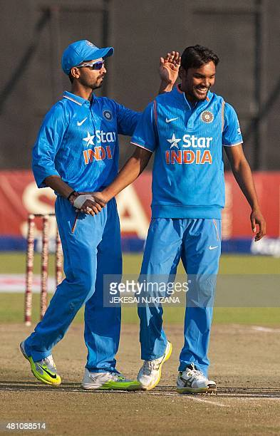 India captain Ajinkya Rahane congratulates bowler Sandeep Sharma after their team's victory in the first of two Twenty20 international cricket...