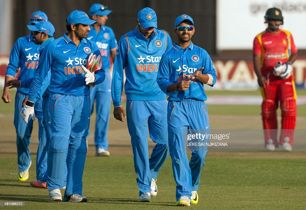 India captain Ajinkya Rahane leads his team off the field after their victory in the first of two Twenty20 international cricket matches between...