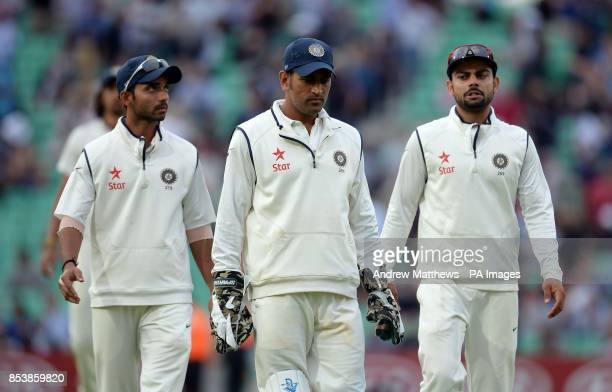 India captain MS Dhoni Ajinkya Rahane and Virat Kohli walk off after day one of the Fifth Test at The Kia Oval London