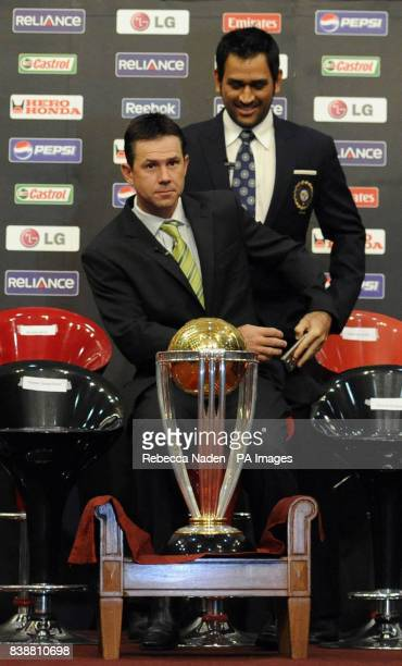 India Captain MS Dhoni and Australia captain Ricky Ponting with the Cricket World Cup trophy during a press conference at the teams hotel in Dhaka...