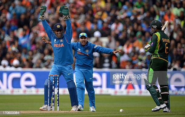 India captain MS Dhoni celebrates the dismissal of Shoaib Malik of Pakistan during the ICC Champions Trophy match between India and Pakiatan at...