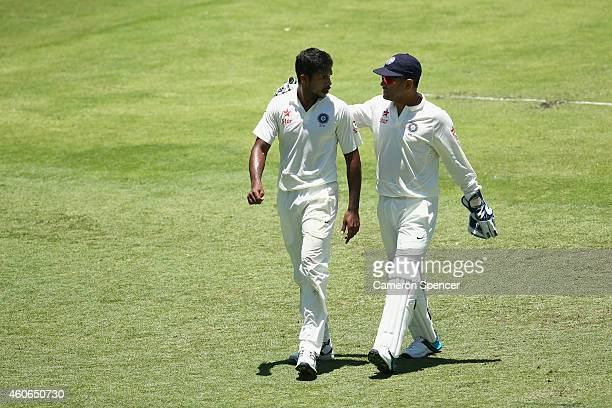 India captain MS Dhoni talks to team mate Varun Aaron during day three of the 2nd Test match between Australia and India at The Gabba on December 19...