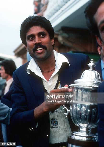 India captain Kapil Dev holds the trophy after the World Cup Final between India and West Indies at Lord's cricket ground in London 25th June 1983...