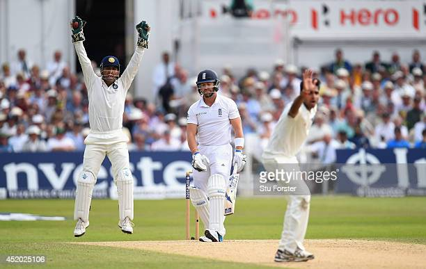 India captain Mahendra Singh Dhoni appeals with success for the wicket of England batsman Matt Prior off the bowling of Bhuvneshwar Kumar during day...