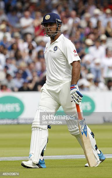 India Captain Mahendra Singh Dhoni walks back to the pavilion following his dismissal for 19 runs during the fourth day of the second Test cricket...