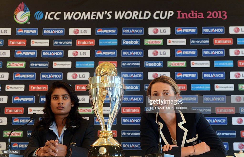 India captain Mithali Raj (L) looks on as England captain Charlotte Edwards speaks next to the ICC Women's World Cup 2013 trophy during a press conference in Mumbai on January 27, 2013. Teams from Australia, England, New Zealand, Pakistan, South Africa, Sri Lanka, West Indies join hosts India for the global event which is being played from January 31 to February 17. AFP PHOTO/Indranil MUKHERJEE