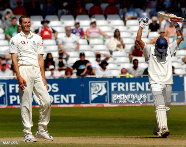 India captain Rahul Dravid celebrates victory as England's Chris Tremlett looks on during the fifth day of the Second npower Test match at Trent...