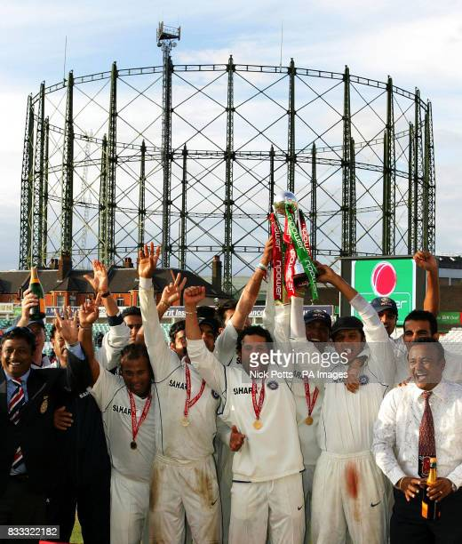India captain Rahul Dravid lifs trophy with Sachin Tendulkar as they celebrate beating England during the fifth day of theThird npower Test match at...