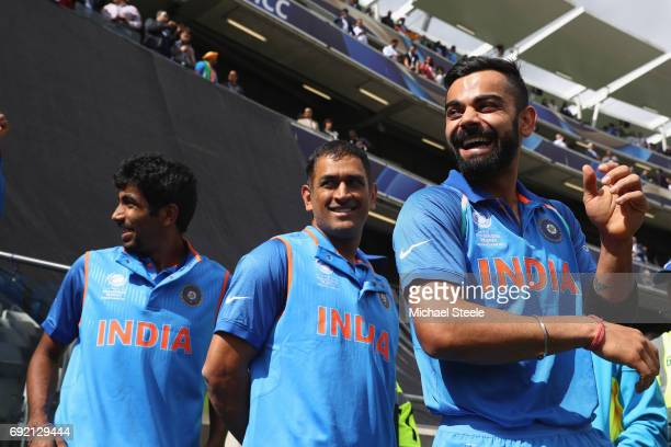 India captain Virat Kohli alongside MS Dhoni and Jasprit Bumrah as the teams wait for the national anthems during the ICC Champions Trophy match...
