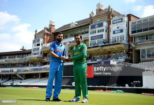 India captain Virat Kohli and Pakistan captain Sarfraz Ahmed hold the ICC Champions Trophy ahead of tomorrow's final at The Kia Oval on June 17 2017...