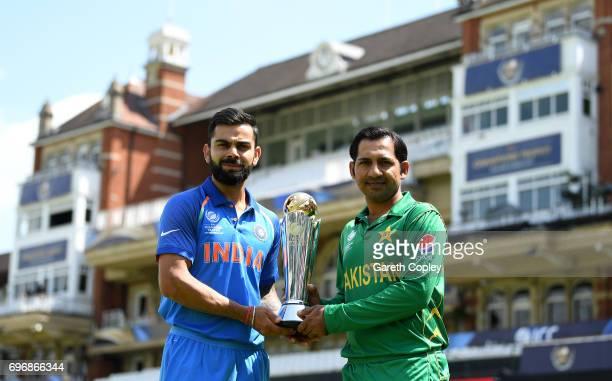 India captain Virat Kohli and Pakistan captain Sarfraz Ahmed hold the ICC Champions Trophy ahead of tomorrow's final at The Kia Oval on June 17 2017...
