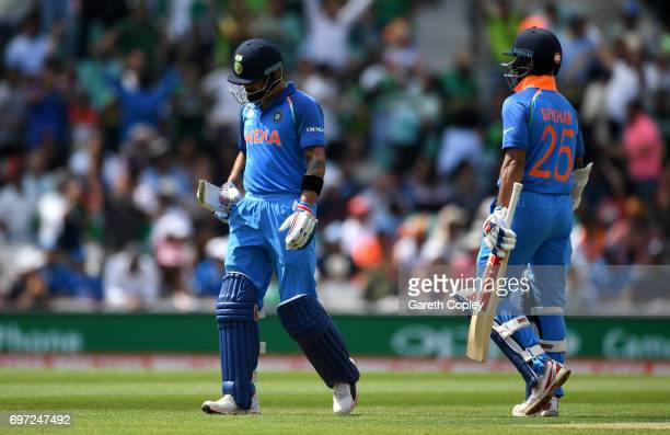India captain Virat Kohli leaves the field after being dismissed Mohammad Amir of Pakistan during the ICC Champions Trophy Final between India and...