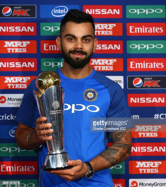 India captain Virat Kohli poses for a photo with the trophy during the ICC Champions Trophy India Press Conference on May 25 2017 in London England