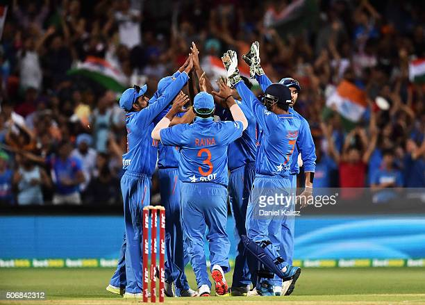 India celebrate after Ashish Nehra of India takes a catch to dismiss Shane Watson of Australia of the bowling of Ravichandran Ashwin of India during...