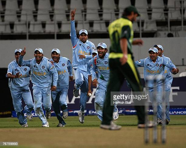 India celebrate as Shahid Afridi of Pakistan misses the stumps in a bowl off giving victory to India after the match was tied at the end of both...