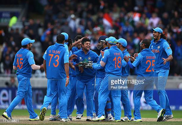 India celebrate taking the wicket of Ian Bell of England after he was stumped by MS Dhoni of India off the bowling of Ravindra Jadeja of India during...