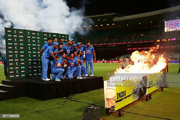 India celebrate with the winners trophy after winning the series during the International Twenty20 match between Australia and India at Sydney...