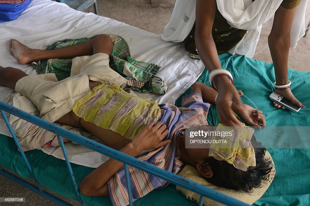 India child Samrat Sinha lies in a ward while being treated for Japanese encephalitisat the North Bengal Medical College Hospital (NBMCH) on the outskirts of Siliguri on July 23, 2014. Outbreaks of encephalitis in India have killed more than 150 people, with health officials on alert fearing the death toll could rise further, state government directors said. Some 102 people have died in West Bengal state from the mosquito-borne virus which affects mainly malnourished children and can cause brain damage and seizures, said medical education director Sushanta Banerjee. Many of the deaths have occurred since the onset of the monsoon season in June when mosquitoes breed in large numbers. AFP PHOTO/ Diptendu DUTTA
