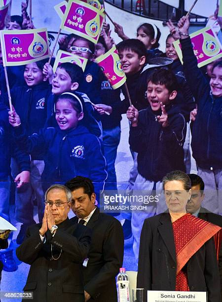 India Congress party President United Progressive Alliance Chairperson Sonia Gandhi watches as Indian President Pranab Mukherjee gestures a greeting...