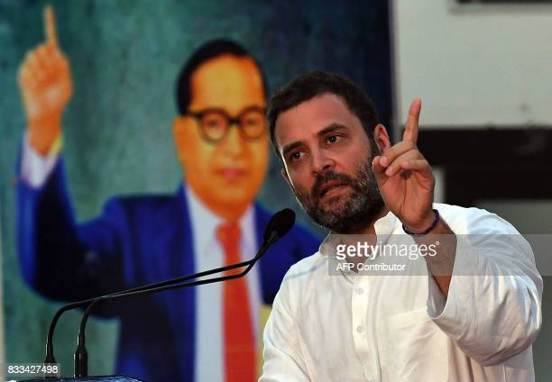 India Congress Party Vice President Rahul Gandhi gestures while delivering his speech during a conclave 'Save Composite Culture' event organised by...