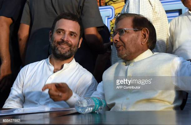 India Congress Party Vice President Rahul Gandhi talks with senior Janta Dal leader Sharad Yadav during a conclave 'Save Composite Culture' event in...