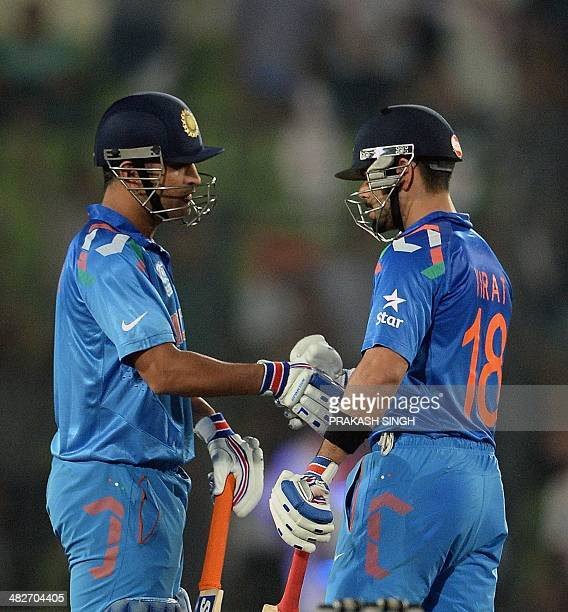 India cricket captain Mahendra Singh Dhoni congratulates batsman Virat Kohli after their victory over South Africa during the ICC World Twenty20...