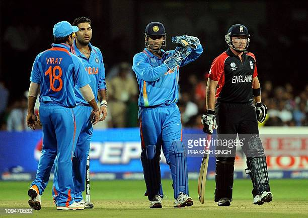 India cricket captain Mahendra Singh Dhoni gestures for a review of a notout decision by the umpire in favour of England cricketer Ian Bell during...