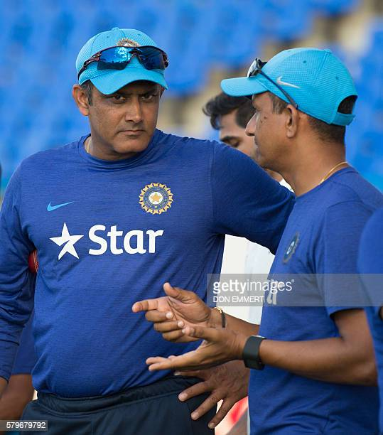India cricket head coach Anil Kumble talks with another coach after day four of the cricket test match between West Indies and India July 24 2016 at...