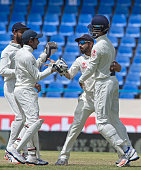India cricket team celebrates during day four of the 1st test cricket match between West Indies and India on July 24 2016 at the Sir Vivian Richards...