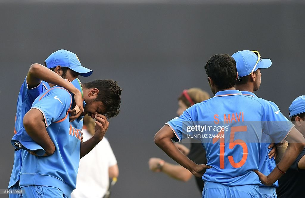 India cricketer Avesh Khan (2R) reacts after losing the Under-19 World Cup cricket final between India and West Indies at the The Sher-e-Bangla National Cricket Stadium in Dhaka on February 14, 2016. AFP PHOTO / Munir uz ZAMAN / AFP / MUNIR UZ ZAMAN