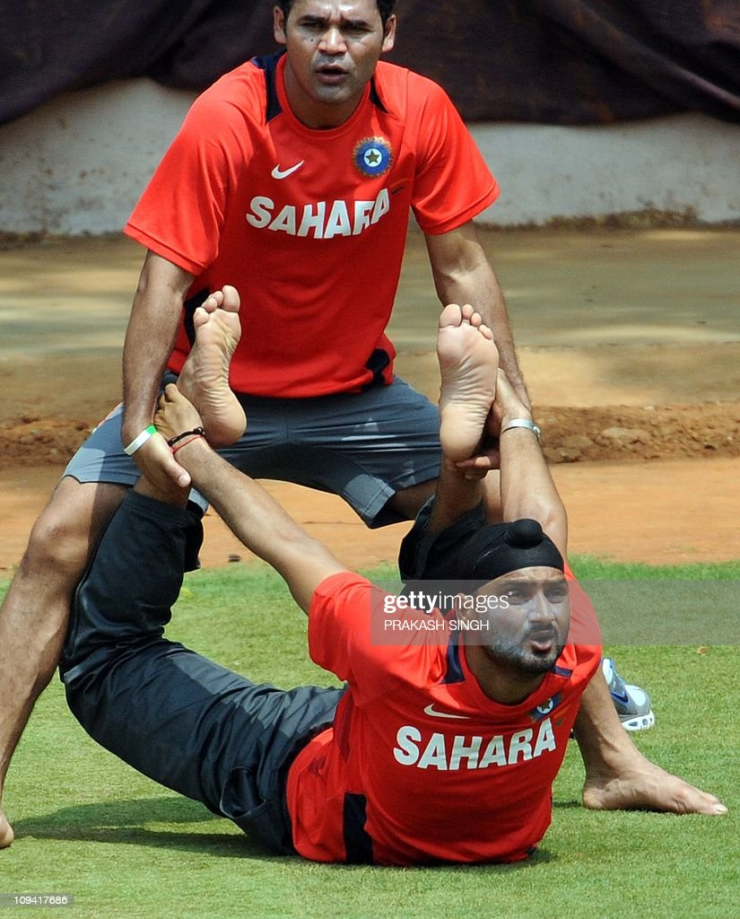 http://media.gettyimages.com/photos/india-cricketer-harbhajan-singh-performs-yoga-during-a-training-at-picture-id109417686