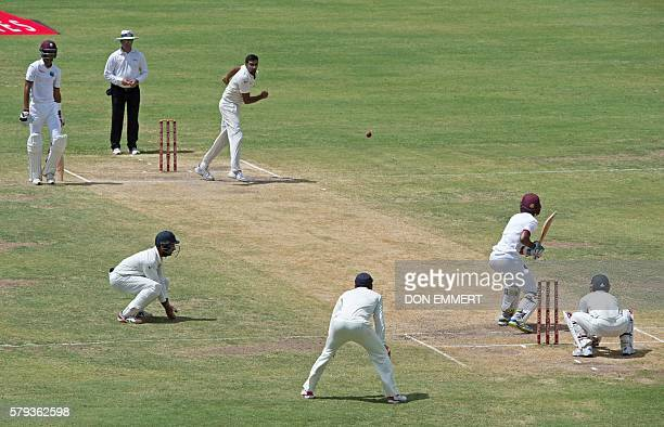 India cricketer Ravichandran Ashwin bowls as West Indies cricketer Kraigg Brathwaite bats during day three of the cricket test match between West...