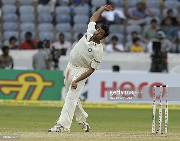 India cricketer Ravichandran Ashwin bowls during the second day of the first Test cricket match between India and New Zealand at the Rajiv Gandhi...