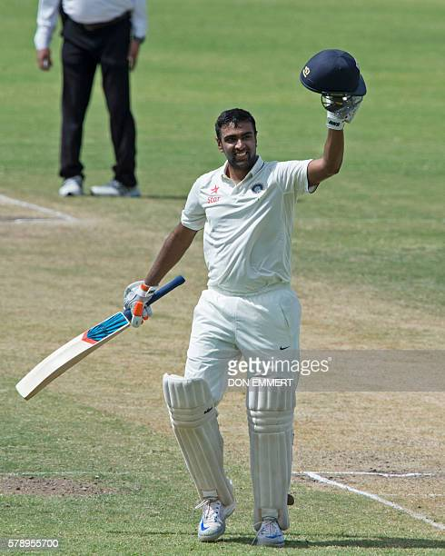 India cricketer Ravichandran Ashwin celebrates his 100th run during day two of the cricket test match between West Indies and India July 22 2016 at...