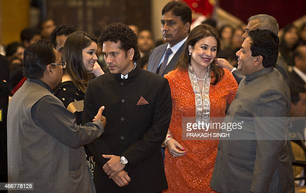 India cricketer Sachin Tendulkar and his wife Anjali Tendulkar interact with people during an awards ceremony at the Presidential Palace in New Delhi...