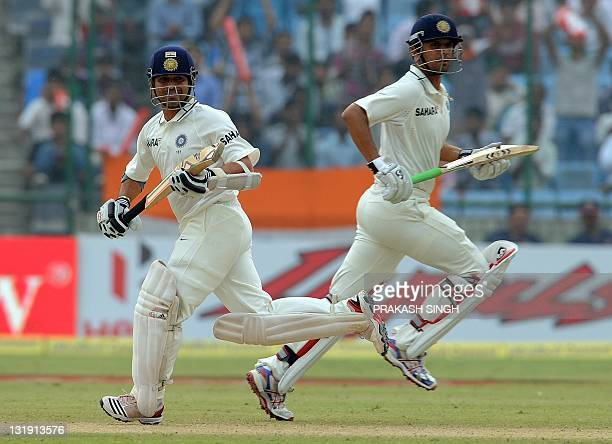 India cricketer Sachin Tendulkar and Rahul Dravid run between the wickets during the third day of the First Test Match against the West Indies at the...