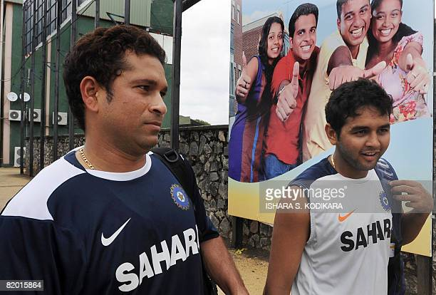 India cricketer Sachin Tendulkar and teammate Parthiv Patel arrive for a practice session at the Sinhalease Sports Club Ground in Colombo on July 21...
