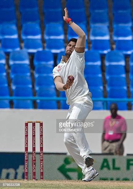 India cricketer Umesh Yadav bowls during day four of the 1st test cricket match between West Indies and India on July 24 2016 at the Sir Vivian...
