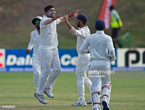 India cricketer Umesh Yadav celebrates during day three of the cricket test match between West Indies and India July 23 2016 at Sir Vivian Richards...
