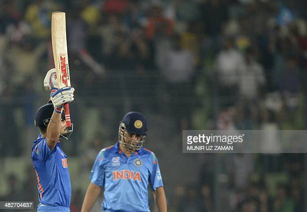 India cricketer Virat Kohli reacts after hitting the final run as captain Mahendra Singh Dhoni looks on after winning the ICC World Twenty20 cricket...
