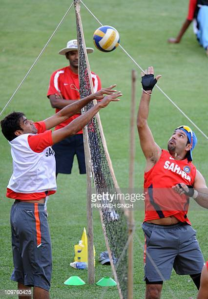 India cricketer Yuvraj Singh and Munaf Patel play a warm up volleyball match during a team training session at The M Chinnaswamy Stadium in Bangalore...