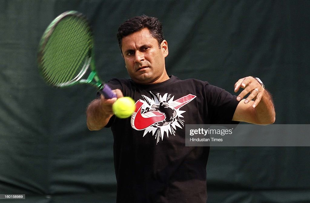 India Davis cup coach Zeeshan Ali plays a shot during practice session at Delhi Lawn Tennis Association on January 27, 2013 in New Delhi, India.