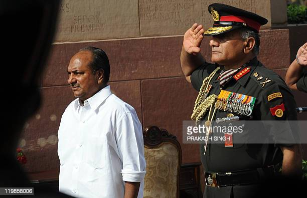 India Defence Minister A K Antony and Indian army chief General V K Singh pay tribute at India Gate during a ceremony to commemorate twelve years...