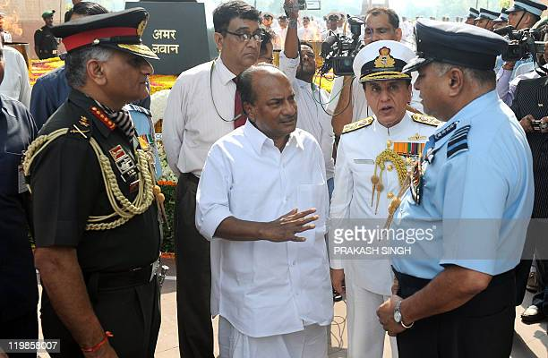 India Defence Minister A K Antony gestures while talking with Indian Air Force Chief Air Chief Marshal Pradeep Vasant Naik as Indian Army Chief...