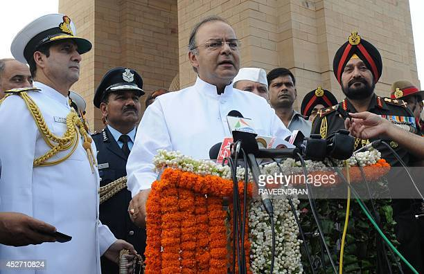 India Defence Minister Arun Jaitely speaks as Army Chief General Bikram Singh and Chief of Navy Staff Admiral R K Dhowan look on during a remembrance...
