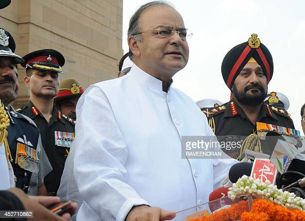 India Defence Minister Arun Jaitely speaks as Army Chief General Bikram Singh looks on during a remembrance ceremony for soliders killed in the 1999...